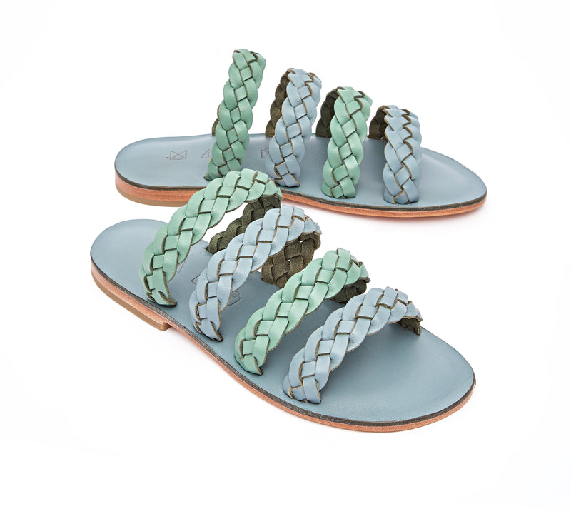 Angled view of the handmade Sea women's braided slip-on leather sandals in light grey insole with light green and grey straps / GREY GREEN