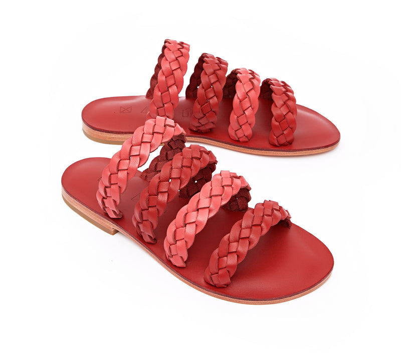 Angled view of the handmade Sea women's braided slip-on leather sandals in red insole with pomegranate and red straps / RED POMEGRANATE