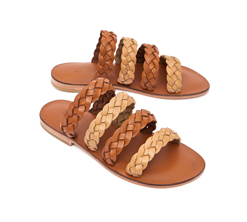 Angled view of the handmade Sea women's braided slip-on leather sandals in light brown insole with natural tan and light brown straps / TAN BROWN