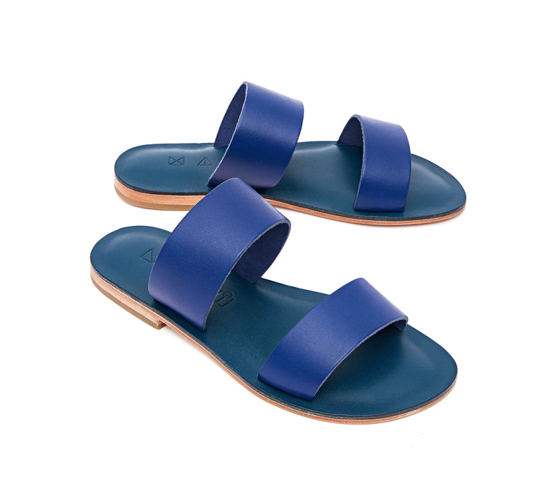 Angled view of the handmade Sun women's slip-on leather sandals in night blue / BLUE