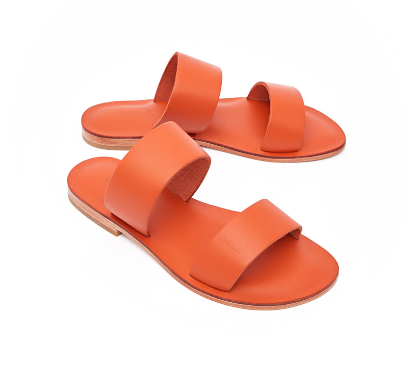 Angled view of the handmade Sun women's slip-on leather sandals in orange / ORANGE