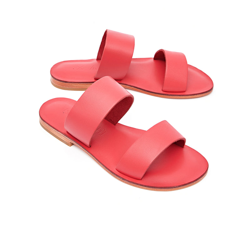 Angled view of the handmade Sun women's slip-on leather sandals in pomegranate / POMEGRANATE