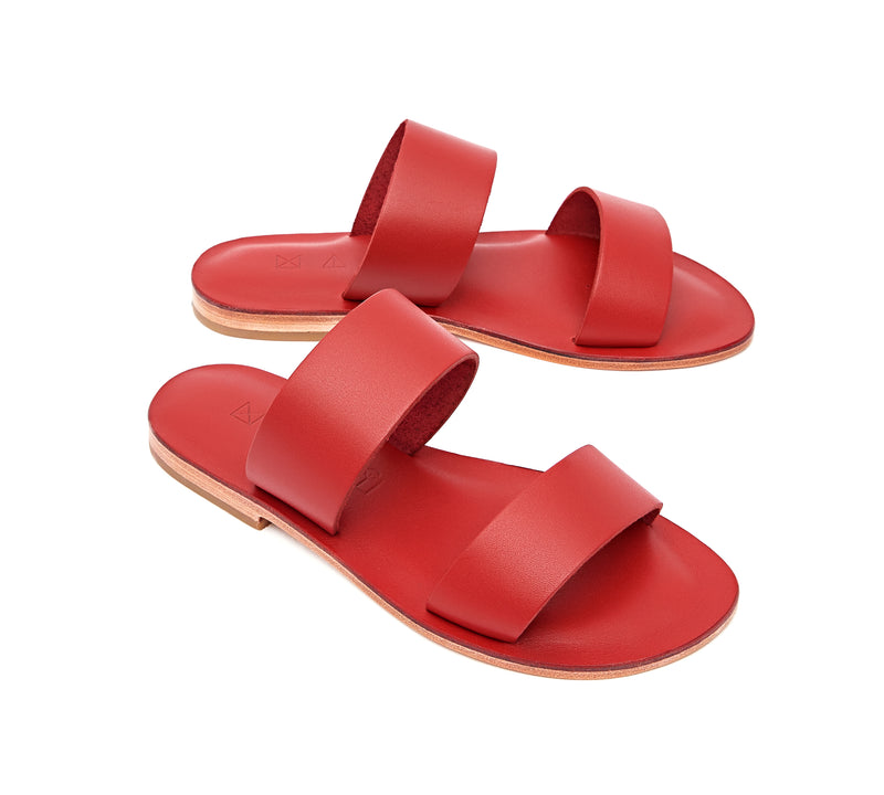 Angled view of the handmade Sun women's slip-on leather sandals in red / RED