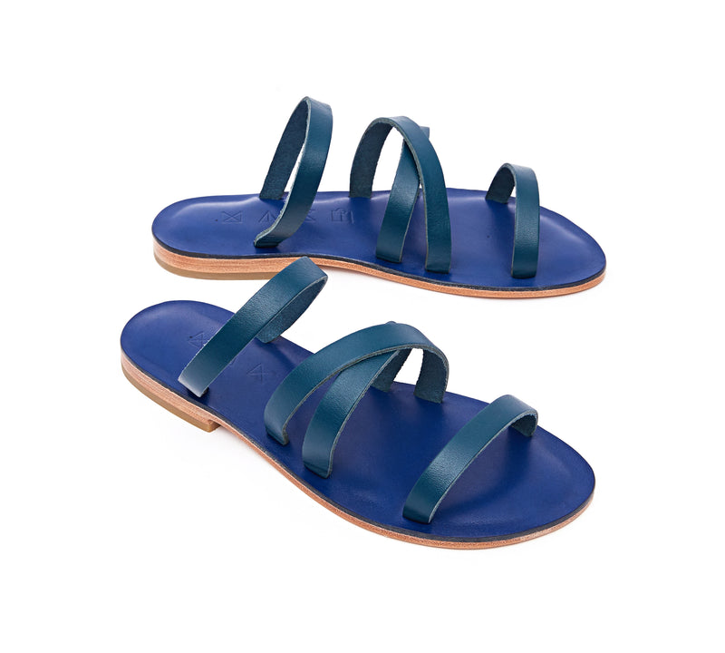 Angled view of the handmade Wind women's slip-on leather sandals in night blue / MEDITERRANEAN