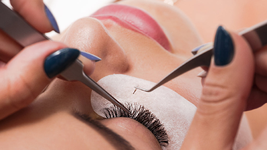 Beauty concept Eyelash extension process on woman close up