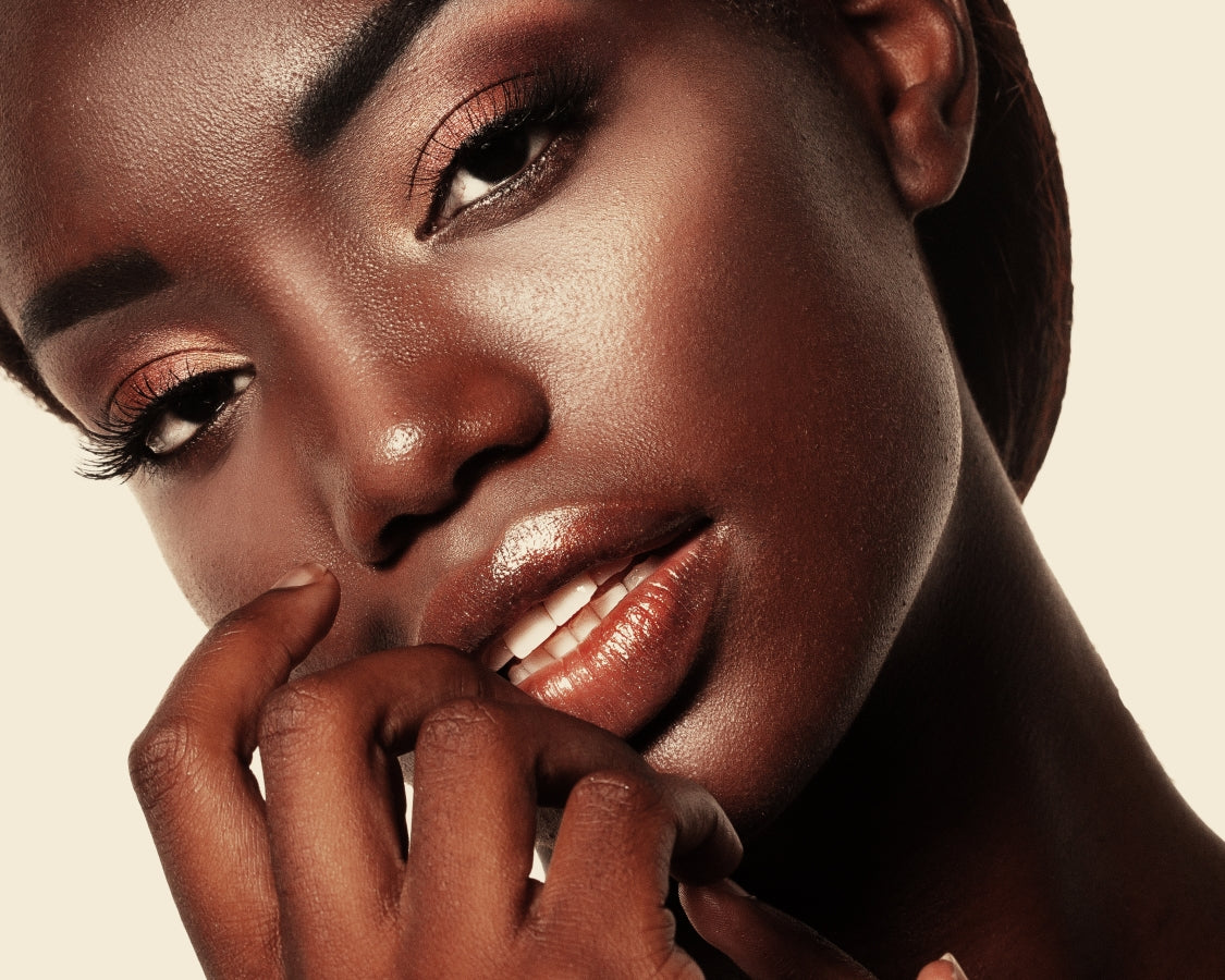 Portrait of Young African model with a beautiful makeup in studi