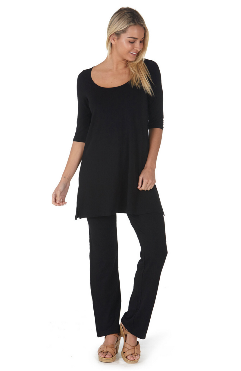 Classic Black Straight Leg Bamboo Pants Worn With Black Tunic Top.