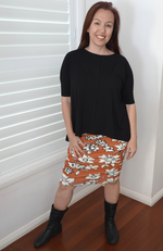 Loose Fitting Bamboo Slouch Top in Black. Fitted Sleeves, One Size Fits All. Worn With Ruched Bamboo Skirt in Orange Wildflower Print.