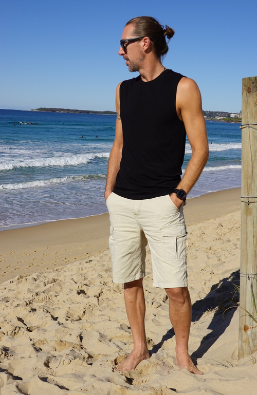 Men's Black Bamboo Sleeveless Shirt worn with Casual Shorts.