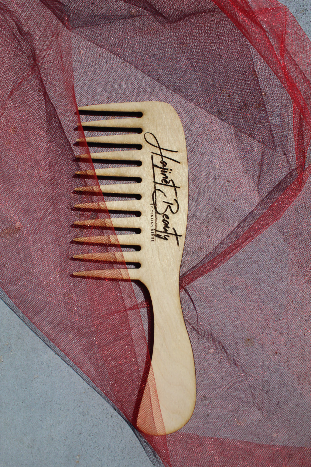 Wooden wide tooth conditioning comb