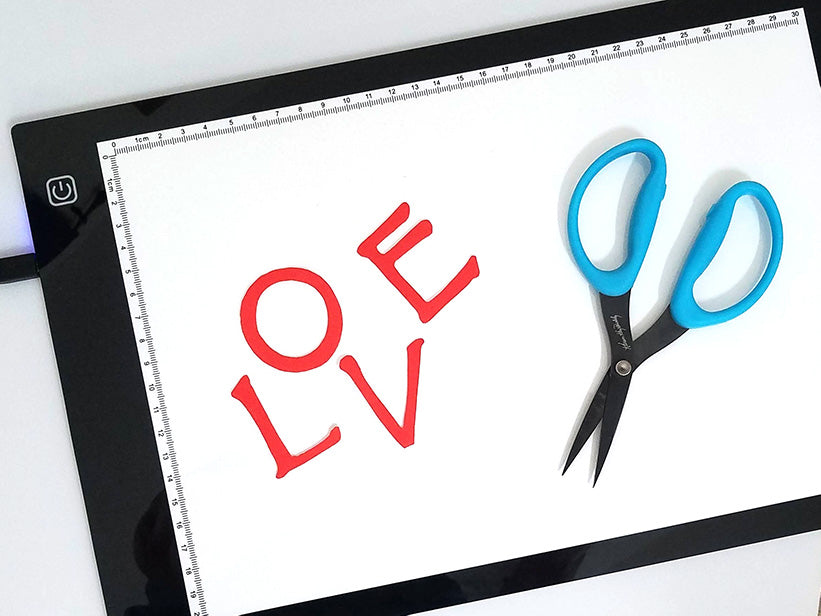 Tools for applique: LED lightbox and sharp scissors.
