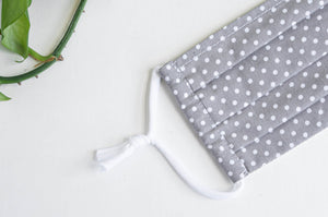 Closeup of Face Mask Grey Ground with White Polka Dots