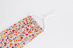 Close Up of Cotton cloth Pleated face mask with Orange Bubbles printed pattern