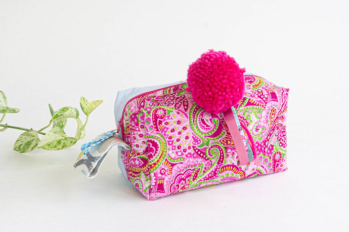 Cotton cloth makeup bag with a Pink Paisley pattern and a big Pink fluffy pompon