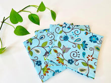 Load image into Gallery viewer, Four folded napkins with a Floral pattern on Blue ground