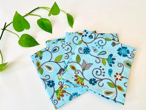 Four folded napkins with a Floral pattern on Blue ground