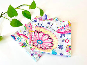 Four folded napkins with a Japanese Umbrellas pattern on White ground