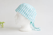 Load image into Gallery viewer, Left Side view of scrub hat with Aqua Stripes on White