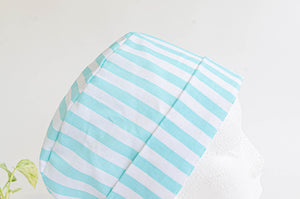 Close up of scrub hat with Aqua Stripes on White