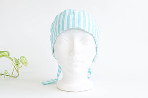 Front view of scrub hat with Aqua Stripes on White