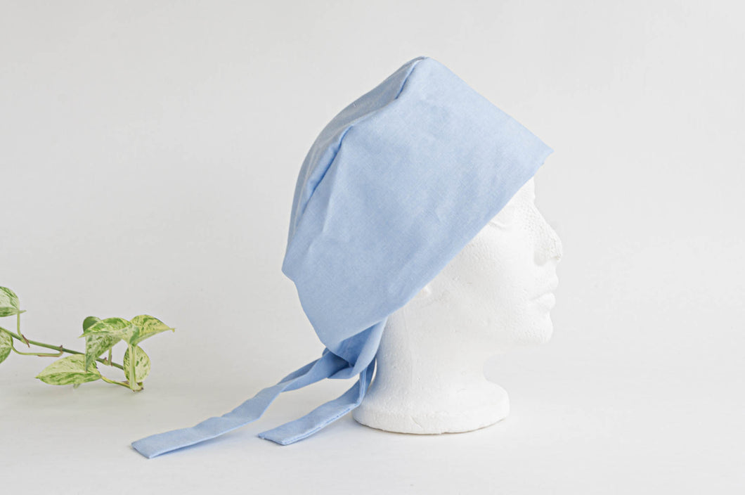 Side view of a Blue Cloth Scrub hat