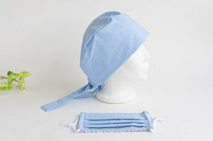 Side view of a Blue Cloth Scrub hat with a matching blue face mask