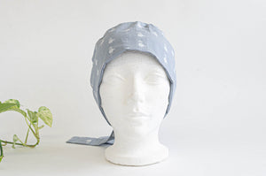 Front view of Cloth scrub hat with White Flamingo pattern on light Grey ground