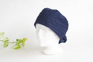 Left side view of Scrub hat White Polka Dots on Navy