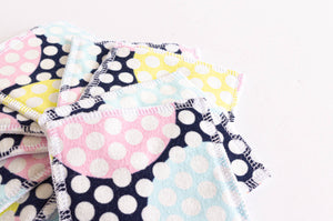 Pile of cloth pads with dots pattern
