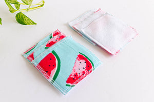 Pile of cloth makeup remover with watermelon pattern on one side and white fleece on the other side
