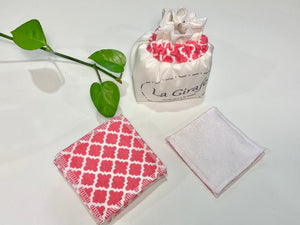 An Ivory cotton pouch with a stack of Salmon patterned makeup remover pads