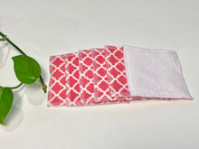Load image into Gallery viewer, A stack of Salmon patterned makeup remover pads with one side in White Polar fleece