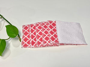 A stack of Salmon patterned makeup remover pads with one side in White Polar fleece