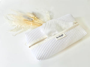 A White tissue dispenser box made of waffle cotton