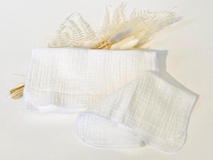A stack of 12 white cotton handkerchiefs