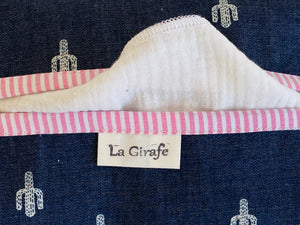 Closeup of a Denim with Cactus pattern box dispenser with Pink trim