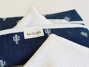 Closeup of a Denim with Cactus pattern box dispenser with White trim