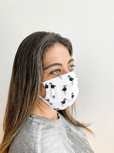 Woman wearing a face mask to show actual size and it on a face