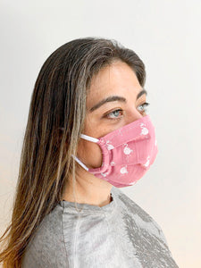 Woman wearing a face mask with White Flamingo printed on Pink Ground