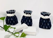 Charger l'image dans la galerie, Three Pouches made of Denim with Pineapple pattern with a stack of white makeup remover pads