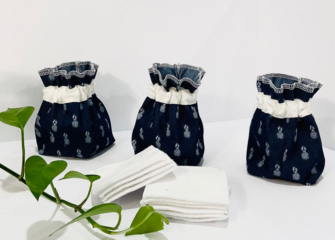 Three Pouches made of Denim with Pineapple pattern with a stack of white makeup remover pads