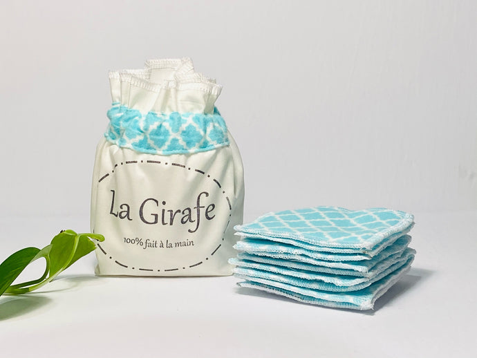 Ivory cotton pouch printed with La Girafe Couture and a stack of Aqua printed makeup remover pads