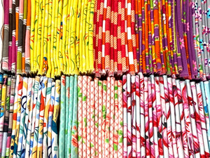 A large variety of colourful folded towels in many patterns and colours