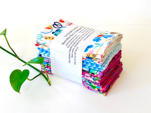 A stack of folded towels with Butterfly, Checks and Garden patterns