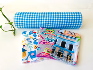 Three folded and one rolled towels with Butterfly, Checks and Garden patterns