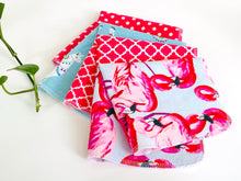 Load image into Gallery viewer, Four folded towels with Flamingo, Lamas and Polka Dots patterns in Pink and Blue