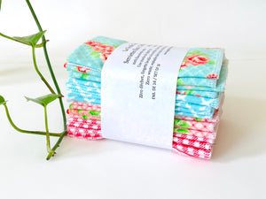A stack of folded towels with Roses and Checks patterns in Blue and Pink