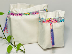 Two bags in off-white cotton with a Butterfly trim. One bag is big and one small.