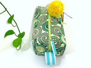 Top view rectangular Cosmetic bag with Green Paisley printed pattern and Yellow Pompon