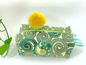 Side view of rectangular Cosmetic bag with Green Paisley printed pattern and Yellow Pompon